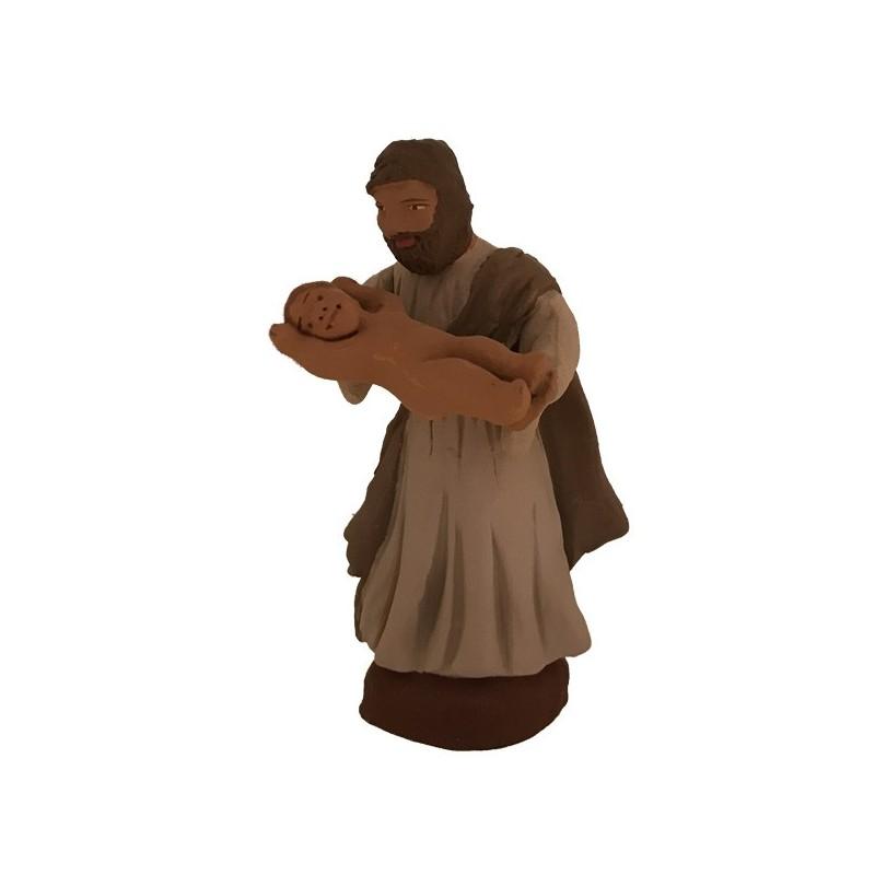 Joseph tenant l'enfant Jésus dans ses bras