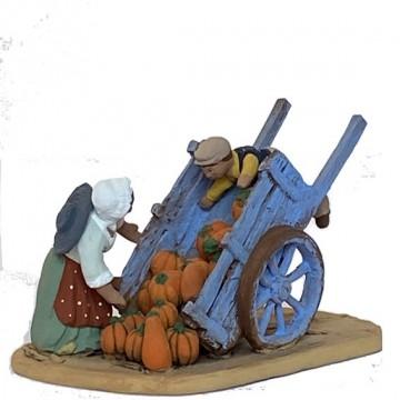 la charrette de courges avec femme et enfant