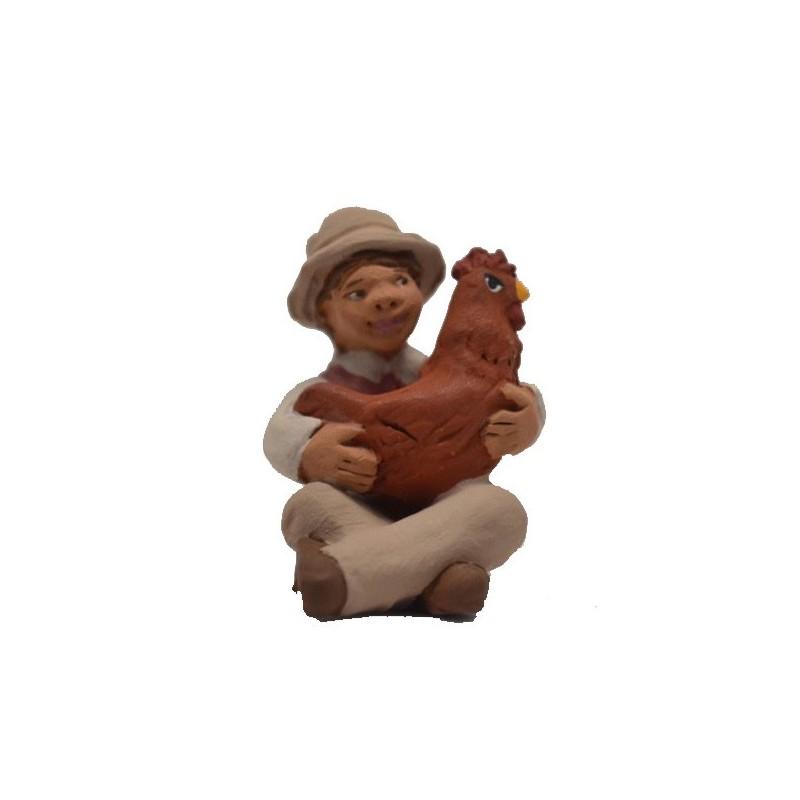 Petit garçon à la poule rousse