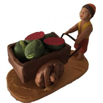 le petit garçon oriental et son chariot de pastèques