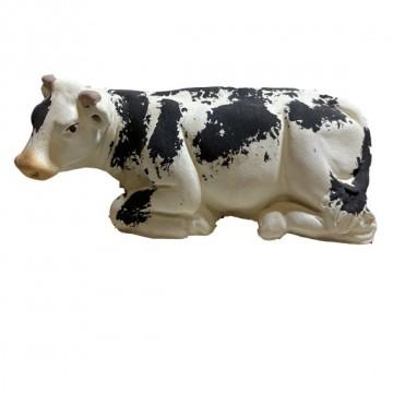 la vache noire couchée