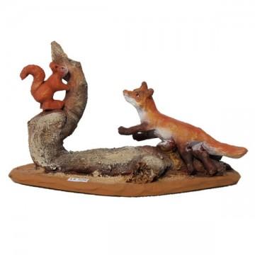 Le renard pourchassant l'écureuil